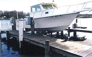 Electric motor low profile boat lift systems for Electric boat lift motor